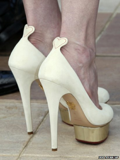 "Kirsten Dunst ivory Charlotte Olympia ""Dolores"" pumps"