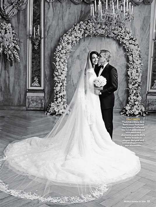 Amal Alamuddin in abito da sposa Oscar de la Renta con George Clooney